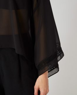 Blusa semitrasnparente con pedrería - Tutto Tempo